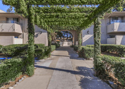 Entrance with a vine covered trellis in The Lincoln on Grand Apartments