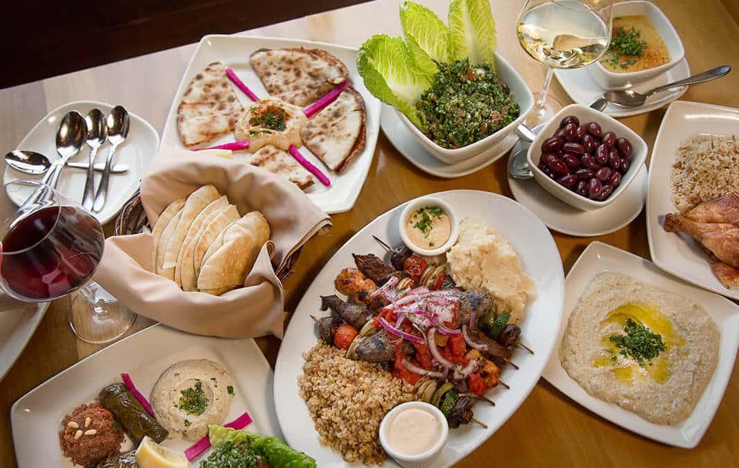 Spread of Mediterannean food on dinner table