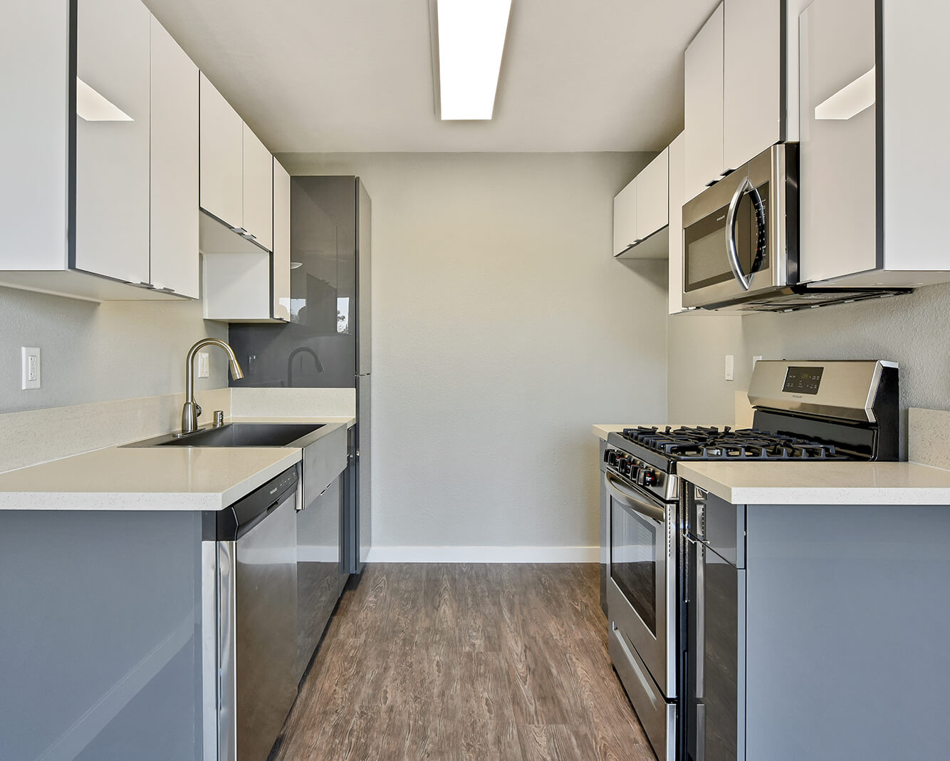 kitchen with stainless steel appliances and new cabinets