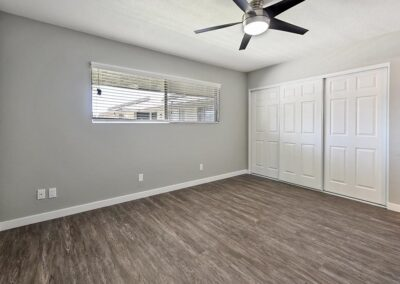 Bedroom with window and ceiling fan and large closet